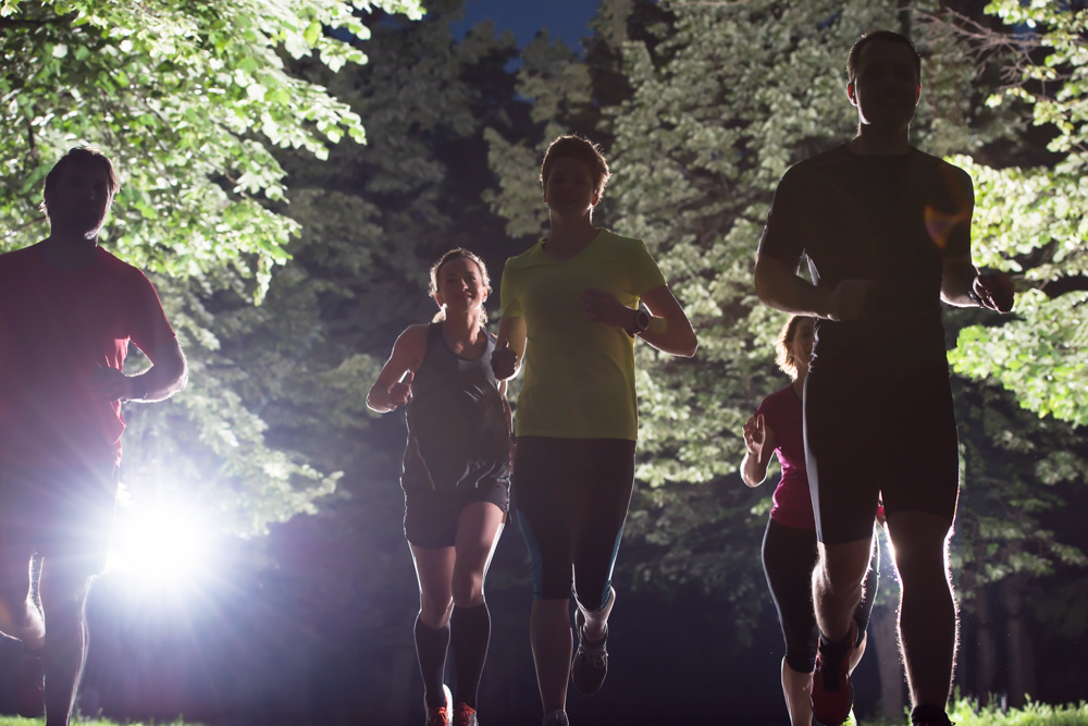 Runners at night on road