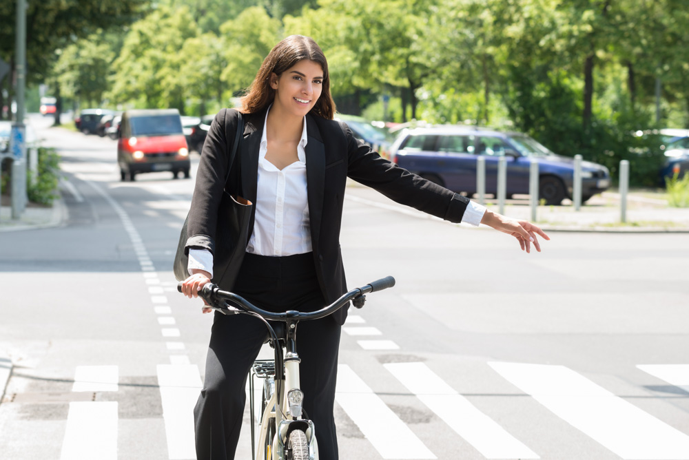 cyclist giving arm signal